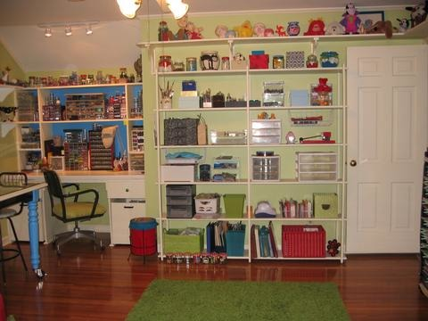 "Craft Room/Guest Room, This is a bedroom converted to my craft room with a ""hidden"" bed.  Used many trash-to-treasure ideas and handy husband., All shelving made by my husband. Covered grandma's desk chair in ultrasuede fabric bought at a yard sale for $1. Most of the storage containers also found at yard sales. Green shag rug online at Linens n Things for $39.00.  , Other Spaces Design"