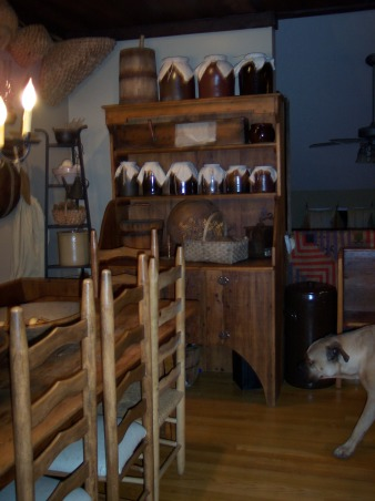 "Country Primitive Dining Room, Here are some pictures of our dining room. I know there is allot to look at...lol But this is the way we like it. I love all the old things....they give me such a ""homey"" feel. We just finished our ""remodel"" on the Dining Room about 6 months ago. Nothing needed to be done but to make this house our home this is what we have done....We add new fixtures boarding up the ceiling & painting the walls & trim. , Oh......now entering the picture is our Bullmastiff ......BO...lol!, Dining Rooms Design"