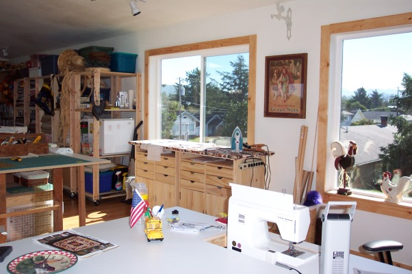 "Dream Quilting Studio, Quilting/Sewing/Hobby Space, Created by putting two ""Hobby Cabinets"" together and placing a padded board on top., Living Rooms Design"
