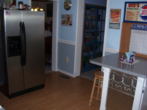 My Folk Victorian Kitchen Redo, Cost only about 2000 dollars for kitchen interior redo! Saved by using existing cabinets and appliances(appliances are newer) then added new hardware counters flooring lights window trim sink faucet plumbing wainscoting new breakfast bar built using existing leftover cabinet all new door and cabinet trim etc..  I tried to use trim to remind of an old victorian kitchen. I got very good deals off Ebay and did all the work myself.  , Oops forgot to remove the stuff off the fridge!  Kitchen leads into dining room to right of fridge  and pantry entry hall on right.  Unseen to left of fridge is doorway to family room.  The fridge I bought two years ago.  It is a whirlpool and was the #1 Consumer Reports recommended model.  I tried to pick a color for the wainscoting that would be close to a color in the countertops.  , Kitchens Design