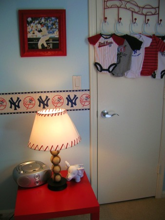 Sonny's Modern NY Yankees Baseball Nursery, Made with lots of love by me and my hubby for our little angel!  The lanterns and rugs are from ikea, storage from target and a ton of the projects were DIY., I bought all the frames at thrift stores and spraypainted them to match. , Nurseries Design