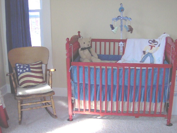 Cowboy Mix nursery/toddler room, Slowly adding vintage finds to complete the room.  I still have a lot of stuff to hang up!  Going mostly with cowboys but also trains Americana old toys and a few other things as well.  Pretty much everything was from ebay or yard sales or dumpster diving., My grandpa's rocker whom my son is named after.  Bedding peices each found separately on ebay., Boys' Rooms Design