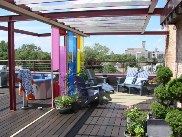 Rooftop Pavilion - Urban Outdoor Living Room , We created a space that was  urban and dramatic yet simultaneously warm and inviting.  A flexible outdoor living room where we are equally comfortable entertaining 50 guests or 5 or just us unwinding in the hot tub or sipping a glass of wine and watching the sunset over the city.  The incredible plexi panels were designed by Johnsen & Schmaling located here in Milwaukee WI.    , , Outdoor Spaces