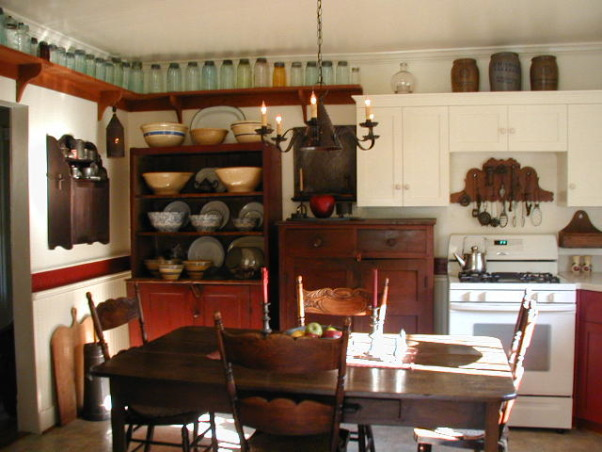 1900 Farmhouse kitchen, When we moved in the bottom kitchen cabinets were tarp blue. There were chicken stencils. The ceiling was drop in tiles. Ripped that out & sheetrocked. Added crown chair rail & beadboard. New cabinets painted them barn red & replaced the butcher block countertop. Added antiques.  Ran the chickens outside! Yeah I know too many fruit jars! Hubby collects them!, Kitchens Design