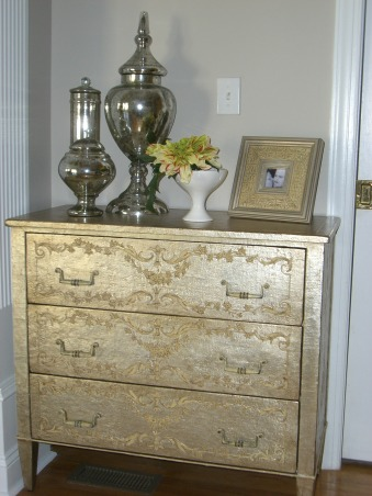 Neat little Niche', Through the pocket door is my laundry room which is also the rear entry where all of our traffic is through the garage.  This chest comes in handy to handle all of the papers my children accumulate and some of our files family calendar and everything else I don't want on my kitchen counters! The chest is hand carved a new item but meant to look antique manufacturer is Theodore Alexander., Living Rooms Design