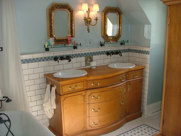 1905 Edwardian Master Bath, Our second bathroom re-do using existing second hand and overstock supplies and a lot of DIY!  This home was built in 1904 without bathrooms. Moved the plumbing around a bit and made this room into a 'period' bath for a family of four from a single-sink no-shower vinyl disaster! Total project was around $5K. All rooms will be updated but period-inspired due to the historical district trends/requirements of this neighborhood., We needed a double sink and didn't go with the reproduction pedestals (for storage reasons).  This 1930s buffet is meant to store bath products for a family of four.  It replaced a single sink pink particle board thing., Bathrooms Design