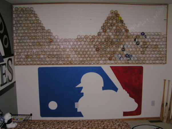 Colorado Rockies baseball room, I created this Colorado Rockies baseball bedroom for my 11 month old son but my 5 year-old  daughter liked it so much she has decided to trade him for a while.  , I hand-painted the 7 foot wide Major League Baseball logo and on top is 489 Major League baseballs that look like they are balanced on the wall.  SInce my daughter and I attend 65-75 Rockies games a year we should have it filled up by the end of next year.  I need about another 250 baseballs to finish it off., Boys' Rooms Design