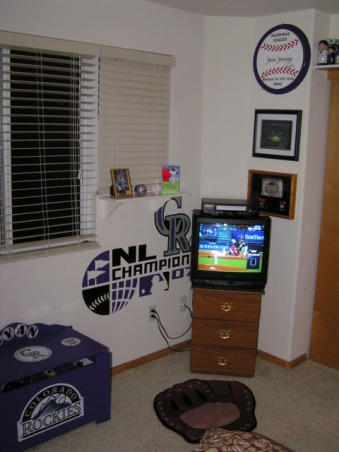 Colorado Rockies baseball room, I created this Colorado Rockies baseball bedroom for my 11 month old son but my 5 year-old  daughter liked it so much she has decided to trade him for a while.  , I hand-painted the 4 foot wide 2007 National League Champions logo also shown is the Rockies toy box I made from a toybox that used to be a Noah's Ark toy box., Boys' Rooms Design