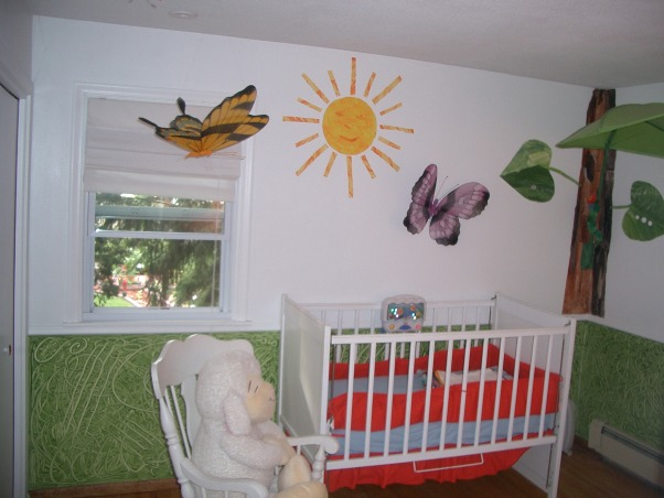 Hungry Caterpillar Nursery, I am a kindergarten teacher can you tell? This room was inspired by Eric Carle's Hungry Caterpillar. We didn't know if we were having a boy or a girl. We had a girl two years ago and she moved on to the pricessroom. Now our baby boy uses this nursery. This room makes me very happy. The day I won't be happy is when I have to try and get all the tissue papers- that are glued to the wall off!!, Bedrooms Design
