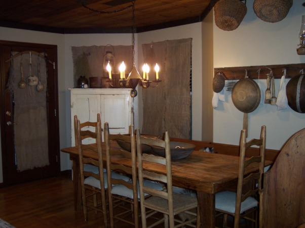 "Country Primitive Dining Room, Here are some pictures of our dining room. I know there is allot to look at...lol But this is the way we like it. I love all the old things....they give me such a ""homey"" feel. We just finished our ""remodel"" on the Dining Room about 6 months ago. Nothing needed to be done but to make this house our home this is what we have done....We add new fixtures boarding up the ceiling & painting the walls & trim. , Here is a picture of our dining room. I know it's allot of stuff...but we like it that way. Thanks for lookin', Dining Rooms Design"