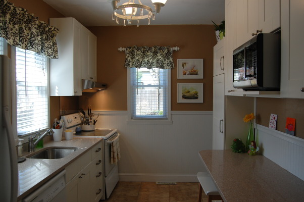 small budget kitchen remodel, 75 year old bungalow home with a small galley kitchen.  Ikea cabinets with silestone countertops and new tile floors update this functional space.  would have loved new stainless steel appliances...maybe later., Kitchens Design
