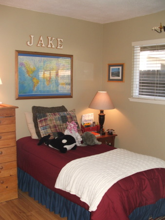 """Asperger bedroom makeover, My 12-year-old son has a form of autism called Asperger's Syndrome.  I felt that his old bedroom was too over stimulating for him so I did a mini-makeover to make it more serene and calm feeling.  He loves it.  His dad built the dresser when Jake was a baby so of course it has to stay.  The drawing is Jake's interpration of  """"The Scream.""""  The sword above the window is from his grandfather a captain in the Marine Corps (two tours in Vietnam).  It's a nice little room....very personal., ...and after , Boys' Rooms Design"""
