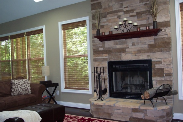 Cozy Hearth Room attached to kitchen, Our hearth room is attached to the kitchen with a wood burning fireplace and breakfast area. We used stacked stone on the fireplace. The ceilings are vaulted with 2 sylights and an overlook upstairs., , Living Rooms Design