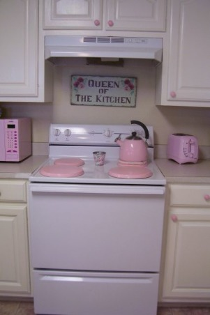 My Cottage Kitchen, This is my kitchen we painted the cabinets white they where finished in a light natural wood before we LOVE this look much better. Eventually we are going to get the matching stainless steel stove and dishwasher. I love pink & blue as you can tell :) I was hesitant to post these pics because this is a specific taste and not everyone likes girlie decorating.  But I LOVE my style and it's brings a big smile to my face when I come home =D ~~Jess , I love my QUEEN OF THE KITCHEN sign it's so me ;) I had trouble finding PINK burner covers so I painted some plain burner covers pink :), Kitchens Design