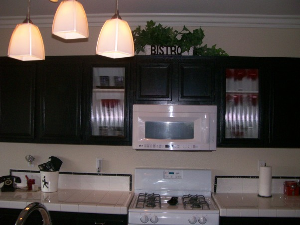 Red, White and Black Kitchen Reno under $1, 000.00 - After and Before- with a few udated photos added:), My brother, sister and I redid my kitchen.   The cupboards were painted and two reed glass inserts were added as well as a market type coffee center.  A new sink and faucet, black trim around the backsplash, lighting,  recovered barstools and a few new accents helped the kitchen fit in better with the dining area and great room., This is after...            , Kitchens Design