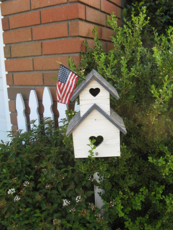 front walkway , front walk way bird house flags and black door, , Yards Design