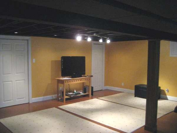 inexpensive asian inspired industrial basement remodel painted black