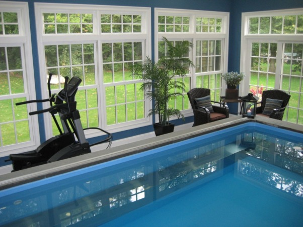 "Indoor Pool and Exercise Room, We recently added this new endless pool and excercise room.  There is a partially inground pool which we trimmed with azek and stone.  The floor is grey tile.  We struggled with wall colors then decided to use the chair pillows and a theme and found Ralph Lauren colors to match.  We're really enjoying the space and hope you like it., The room as lots of windows so the room is always bright.  The room is 22 X 24 feet and the pool is 10 X 16 inside dimensions and is 50"" deep., Pools Design"