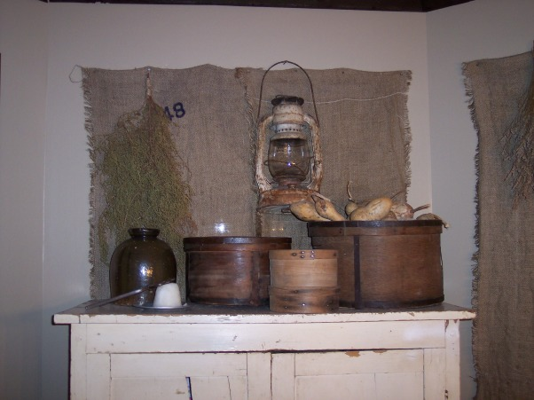 "Country Primitive Dining Room, Here are some pictures of our dining room. I know there is allot to look at...lol But this is the way we like it. I love all the old things....they give me such a ""homey"" feel. We just finished our ""remodel"" on the Dining Room about 6 months ago. Nothing needed to be done but to make this house our home this is what we have done....We add new fixtures boarding up the ceiling & painting the walls & trim. , Here is some more burlap curtains.....and part of my little collection of Dry Measures........and of course more Brown Stoneware. ....and the little white thing is a Sugar Cone & on top of it some Sugar Nippers. , Dining Rooms Design"