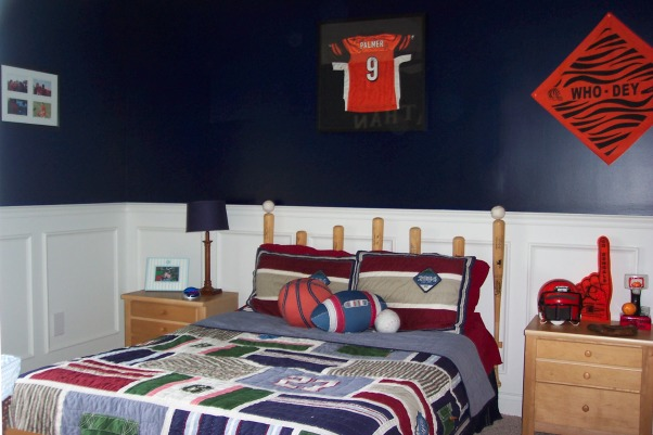 Little boys sports room , This is our little boys sports room. It is navy blue with the bottom in white wainscoating. , , Boys' Rooms Design