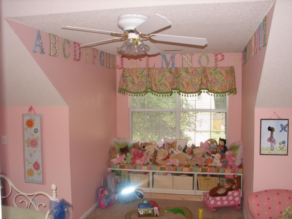 Jada's Big Girl Room, Our daughter just turned 3 so we thought it was time for her to have a big girl room. She loves this space and I am happy we were able to give it to her. It is still a work in progress but this is what we have so far. It is supposed to be butterfly themed but I still have to add some more butterfly accessories. This room is over our garage and used to be our den. We decided to move her room here so that it could double as a playroom. I will update with more pics when the I make changes, This is a view of the window seat. I plan to get rid of some of those stuffed animals. I had the entire alphabet custom painted to match the room. I got the idea from Land of Nod. , Girls' Rooms Design