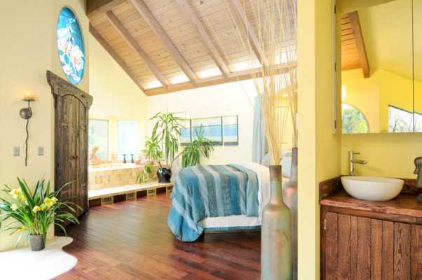 old world meets modern design, My dilema  when remodeling the previously country/lodge style bedroom with pine ceilings blue carpet and the stained glass window was that  I love the modern style yet I didn't want to part with the beautiful stained glass.  So I bridged the two by going with old world traditional dark rustic wood.  I introduced a water element with hues of blues and greens and yellow to compliment the stained glass.  , , Bedrooms Design