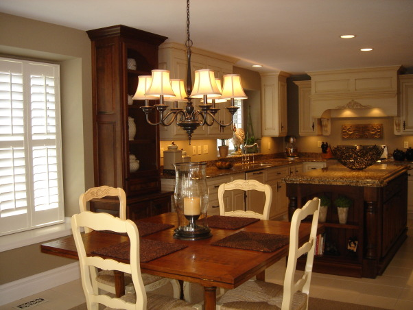"HGTV RMS Inspiration Room - my new kitchen photos, My kitchen is one of the inspiration rooms on episode #208 of the Rate My Space Show. Thank you Angelo, Jillian and HGTV for choosing my kitchen as an inspiration room. It was quite an honor and a lot of fun being on the show. I renovated my kitchen a couple of years ago. We went from an outdated 1980's kitchen to this. The original kitchen had pickled oak cabinets with white formica countertops. I wish I had taken a ""before"" picture to show you. The change is remarkable., There are 2 tall dark cherry cabinets one on each side of the window. I have used french wire (chicken wire) in the upper doors of the tall cabinets. I use these cabinets for display. Below is closed door storage.          , Kitchens Design"