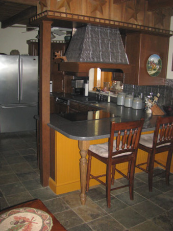 1800's Farmhouse Kitchen Makeover on a budget, A budget redo of an 1800's farm house kitchen. It was 70's retro complete with a yellow formica countertop and white linoleum floor. We wanted to bring a more primitive & period feel to the space., With a muddy farm and dogs galore we resurfaced the floor with rustic slate for easy cleaning and a great way to conceal the dirt that gets dragged in. To add seating we extended the counter past the stove to bring two more bar stools in. We enjoy having breakfast or coffee there each day.  We updated the appliances and repeated the silver theme with tin tiles as back splash. The hood over the stove is in the process of being covered with the tin material as well., Kitchens Design