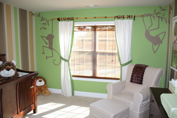 "Sawyer's Safari Nursery, We can't wait for our little guy to get here to enjoy his room! We hope he loves the friendly fluffy animals and colorful stripes as much as we do!, The ""monkeys"" are swinging from a bamboo rod that we decided to use as a curtain rod.  The monkeys were painted by a local artist., Nurseries Design"