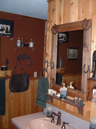Modern Outhouse, This guest bathroom was bright cotton candy fuscia and really dull gray and woodtone mica when we moved in.  We are dreaming of the day we move to the mountains but thought we could bring some of it home now. My husband made the mirrors and did all of the woodwork on the walls. Friends and family love being using our modern outhouse when they visit.  We created the guest bedroom with the same feel. , Bathrooms Design