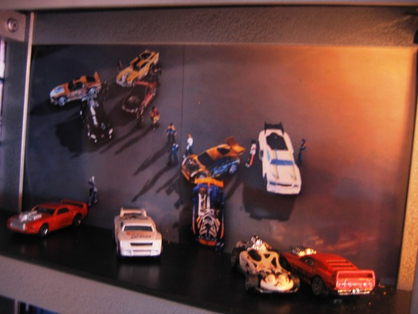 Hot Wheels & Corvette Heaven, The boys love Hot Wheels and Corvettes. The track starts at the top of room and goes all the way around with several different tracks intersecting. The track looks great at night because I used rope lighting to follow the entire track. The Corvette bumpers and gauges are real from a real 1978 Corvette., Boys' Rooms Design