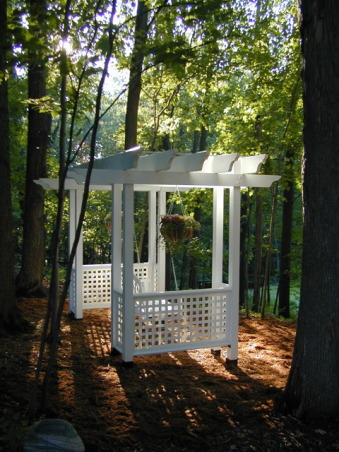 Swing Arbor, This is a swing arbor that I designed and constructed. It sits a top a hill overlooking our large pond. At just the right time of day the sunlight shines through the trees setting a devine glow., Gardens Design