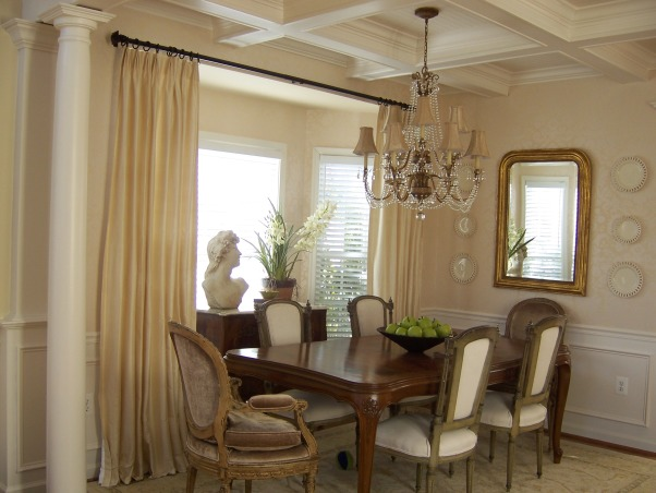 french dining room, soft tones of cream make this an elegant formal dining room, We added the columns wainscotting and coffered ceiling to add some architecure to an otherwise plain space. Its open w/the great room so also adds much needed separation. , Dining Rooms Design