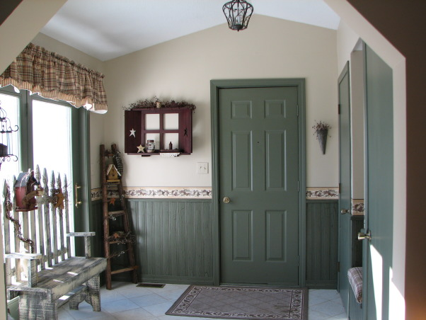 Breezeway entrance, This is my breezeway entrance  The wainscotting and woodwork were stained originally and I decided I needed some color so I crackled it with black underneath and colonial green on the top.  The doors and trim are solid colonial green., Other Spaces Design