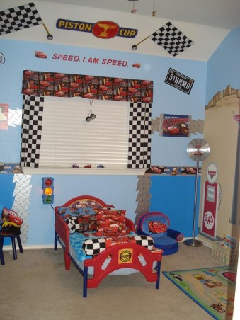 Cars Theme boy's room, My husband and I worked on the wall mural together the gas pump and sign has our last name and we used appliques for the cars driving along the road. The lake and lake island were created so we can name something after the kids. I made the window treatments and bed pillows. My husband created the light fixture silver floor clock and picture framed pieces. We went alittle overboard with the Cars theme but the boys love it!, I made the flags window treatments and pillows. You can't see it in the picture but the ceiling fan is also a Cars fan we installed. My husband connected a wall clock to a floor light stand and we added Cars stickers to give it a custom look. , Boys' Rooms Design