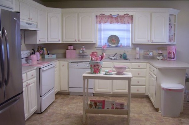 My Cottage Kitchen, This is my kitchen we painted the cabinets white they where finished in a light natural wood before we LOVE this look much better. Eventually we are going to get the matching stainless steel stove and dishwasher. I love pink & blue as you can tell :) I was hesitant to post these pics because this is a specific taste and not everyone likes girlie decorating.  But I LOVE my style and it's brings a big smile to my face when I come home =D ~~Jess , This is a temporary island till I can find an antique dresser to convert into an island. CHECK OUT MY BLOG http://decoratinghousewife.blogspot.com, Kitchens Design
