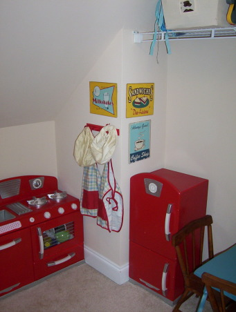 "Old playroom pics, This is our ""playroom"" in our new house. I used vintage furniture and bright colors to make this fun. I am moving my boys into twin beds so I moved their custom toddler beds into this nook in their playroom now when we have my neice and nephew over we have an extra sleeping area! But when no one extra is staying over they are great for ""jumping on the bed"". My favorite thing in this room would have to be the bright IKEA rug!, Boys' Rooms Design"