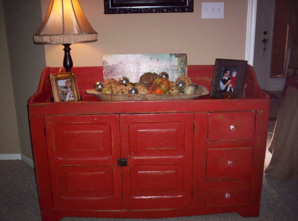 Restored Pennsylvania Dry Sink, I found this in someones trash!  It was sad and faded.  I sanded painted with a red stain from IKEA and added glass knobs.  The crow picture I painted and also painted the frame found at a garge sale. I LOVE to repurpose or restore sad old items.  , , Living Rooms Design