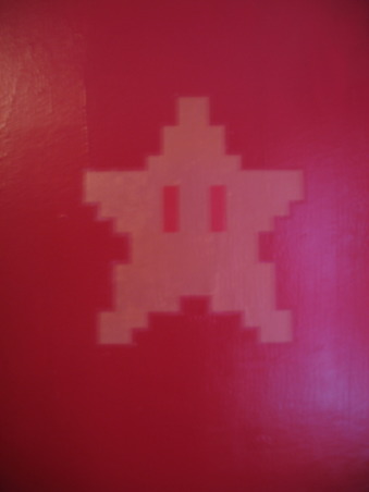 Super Mario Brothers, Classic 80's Super Mario Brothers theme! Includes hand painted canvas of the last level of Super Mario Brothers a hand made quilt of a pixeled Mario and Super Mario wall decals! Lots of work and love!, Closer door with star decal, Nurseries Design
