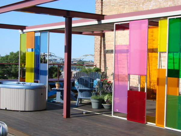 Rooftop Pavilion - Urban Outdoor Living Room , We created a space that was  urban and dramatic yet simultaneously warm and inviting.  A flexible outdoor living room where we are equally comfortable entertaining 50 guests or 5 or just us unwinding in the hot tub or sipping a glass of wine and watching the sunset over the city.  The incredible plexi panels were designed by Johnsen & Schmaling located here in Milwaukee WI.    , Outdoor Spaces