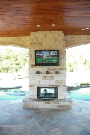 Texas Style Outdoor Room / Kitchen, We like to spend time outdoors but in Houston Texas you need a covered space and pool to keep cool most of the year. We designed our outdoor living space to be an extension of the indoors. It includes a sitting area dining area and outdoor kitchen.  We would love to hear what you think!(The palm design over the fireplace is not artwork.  It is a flat screen tv cover.), This flatscreen gets lot of use.  It also doubles as computer monitor for our Media Center PC which is remotely located in the house.  One remote controls everything and lets us easily select any kind of music for the crowd without going inside!, Patios & Decks Design