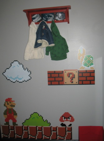 Super Mario Brothers, Classic 80's Super Mario Brothers theme! Includes hand painted canvas of the last level of Super Mario Brothers a hand made quilt of a pixeled Mario and Super Mario wall decals! Lots of work and love!, This is the first wall with Super Mario Brother decals!, Nurseries Design