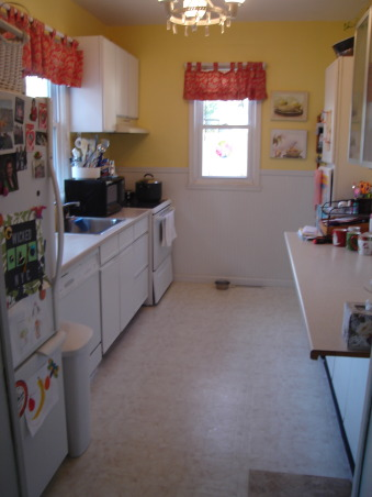 small budget kitchen remodel, 75 year old bungalow home with a small galley kitchen.  Ikea cabinets with silestone countertops and new tile floors update this functional space.  would have loved new stainless steel appliances...maybe later., BEFORE  UPDATE, Kitchens Design