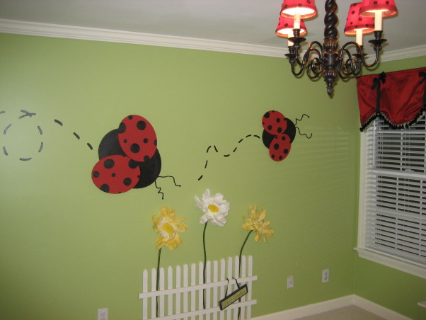 Little Girl's Playroom, A darling organized playroom.  I designed this space to  keep my daughter's toys from taking over the room.  My husband built the furniture and I did everything else (made all artwork made window treatments covered all lampshades).  The room has plenty of floor and desk space for playing and learning.  The mural is 3-D with ladybugs made out of oval artist's canvasses huge paper flowers and a homemade picket fence.  , Girls' Rooms Design