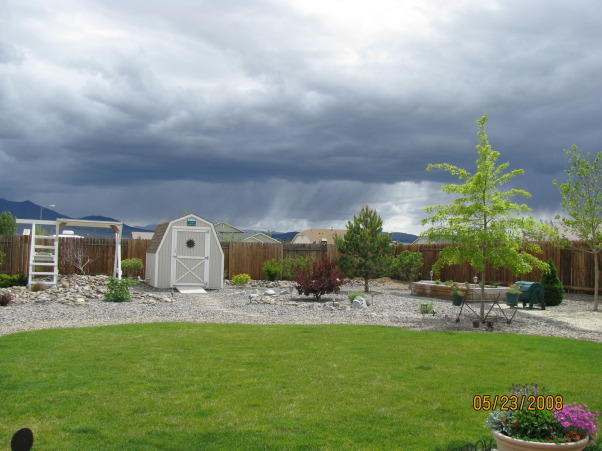 Did it ourselves park-like setting, Our backyard was nothin' but dirt 6 years ago. We have s-l-o-w-l-y added trees shrubs rock and accents to make it our favorite place to hang out  whenever the weather permits., Stormy sky view., Yards Design