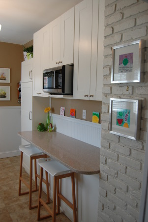 small budget kitchen remodel, 75 year old bungalow home with a small galley kitchen.  Ikea cabinets with silestone countertops and new tile floors update this functional space.  would have loved new stainless steel appliances...maybe later., we were able to put this kitchen together with $5000 and lots of elbow grease., Kitchens Design