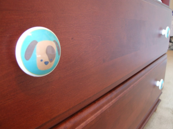 Brody's Room, This room decor was inspired by the prints of one of our favorite artists Stephen Huneck.  We have three dogs and hope that Brody is a dog lover too!, Close up of the doggie drawer pull, Nurseries Design