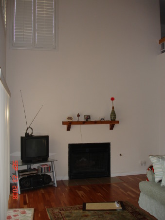2 story - fireplace wall, small fireplace and a huge wall.  I need decorating ideas, , Living Rooms Design