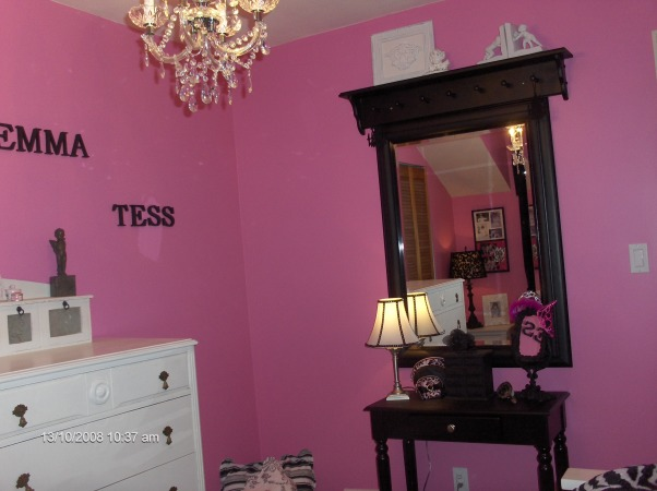 "Chic Bedroom Surprise for 8yr old girl, We've redecorated my daughters' room for a surprise!  She wanted a ""Chi-Chi Frou-Frou Paris Room"" so we went with Hot pink black and white.   This was really a reno on a budget as it cost us less than $350 as we had most of the things from her previously shabby chic room.  She shares her room with her 2 1/2 yr old sister so we made good use of a small space with a trundle bed and little sis sleeps below.  A few things to do...paint closet door paint baseboards & window trim white., Only new purchases here are the vanity table the chandelier and the cushions on the floor...the rest we used from her previously chabby chic room...with a little paint we've changed the look dramatically!!, Girls' Rooms Design"