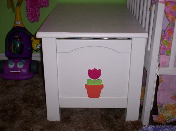 My work in Progress, This is our nursery for the little girl that we are going to foster and hopefully adopt the space is still in progress so any suggestions and comments that you have would be greatly appreciated.  Thanks , This is the side of the toy box i made the flowers so they can come off just in case of some weird thing we end up with a boy the whole room can be changed over for a boy in less then an hour, Nurseries Design